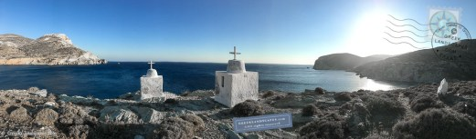 Two white shrines with crosses overlooking the sea