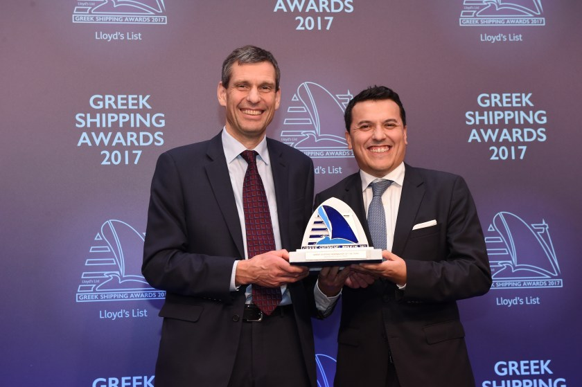 Ian White of sponsor ExxonMobil presenting the Greek Shipping Newsmaker of the Year Award to Carlos Pena, accepting on behalf of John Michael Radziwill.
