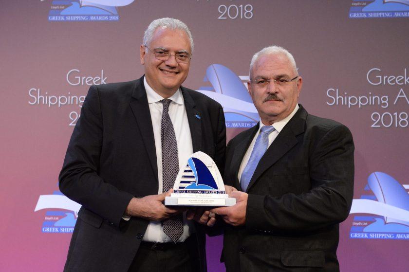 "Dr. Loukas Barmparis of sponsor Safe Bulkers, Inc. presenting the Seafarer of the Year Award to Capt. Efstratios Kavros of ""Eleftherios Venizelos""."