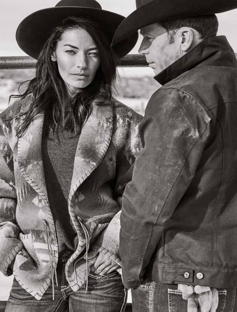 Nicole and Taylor Sheridan wearing Greeley Hat Works custom hats on their ranch in Utah.