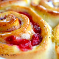 Peppered Cranberry Breakfast Buns with Orange, Honey & Vanilla Syrup