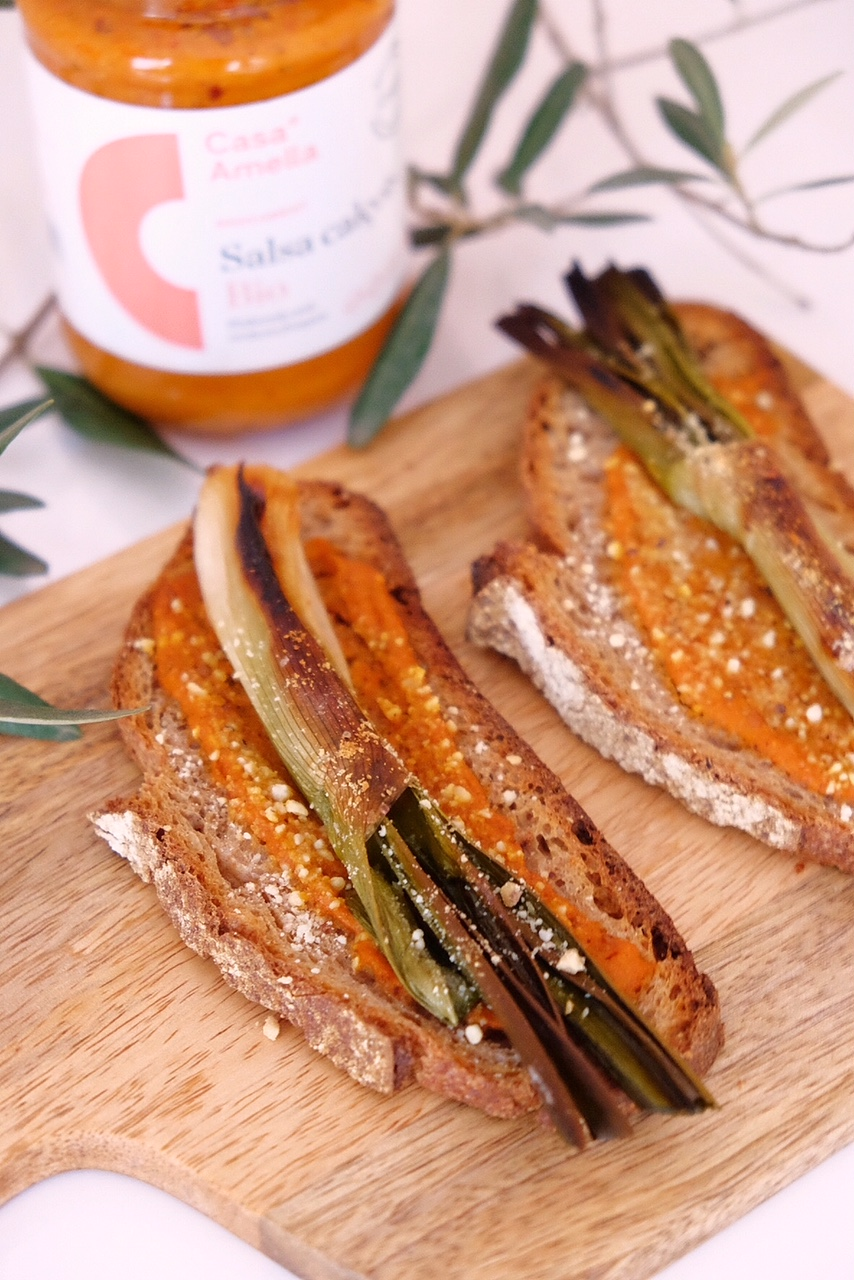 Oven made calçots toasts, with some organic calçots sauce