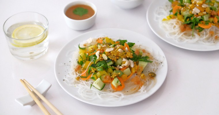 Rice noodle salad with raw vegetables and peanut sauce