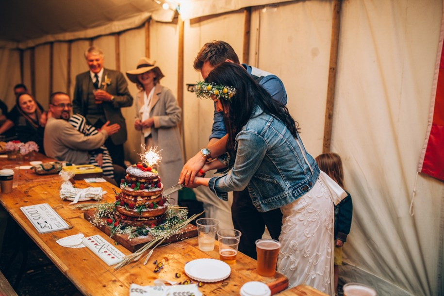 the good life experience festival wedding bride and groom cutting the cake by hawarden photographer