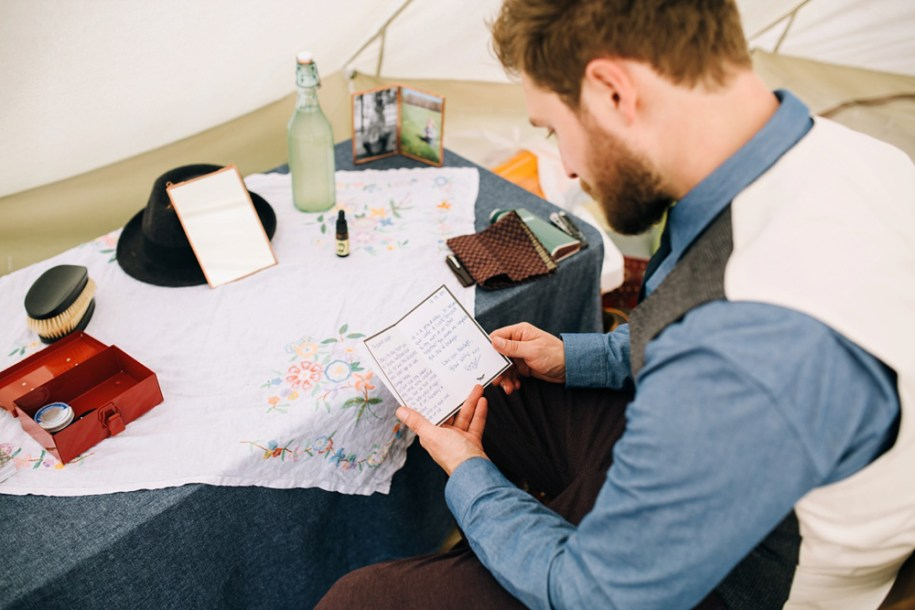 Groom reading notes before the ceremony by Hawarden festival wedding photographer