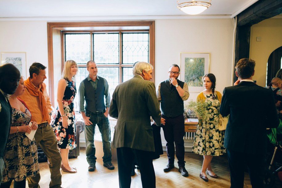 Guests waiting for the bride and groom to arrive by Hawarden wedding photographer