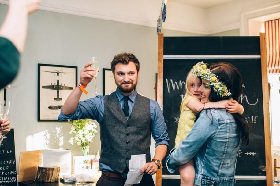 groom raising the glass by hawarden wedding photographer