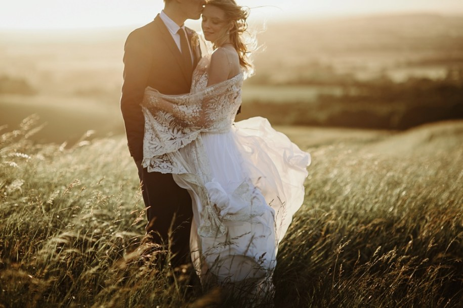 bride and groom at sunset on white horse hill in oxfordshire