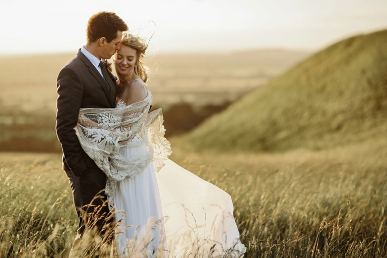 beautiful bride wearing a custom made wedding dress during a sunset photo shoot