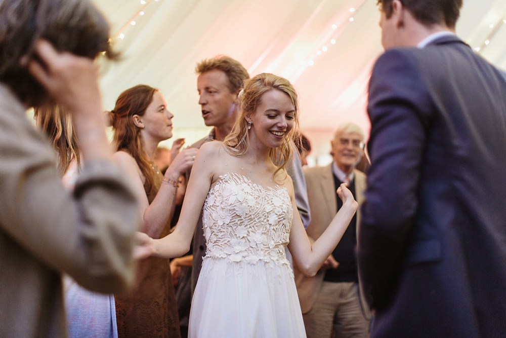 bride dancing at marquee wedding