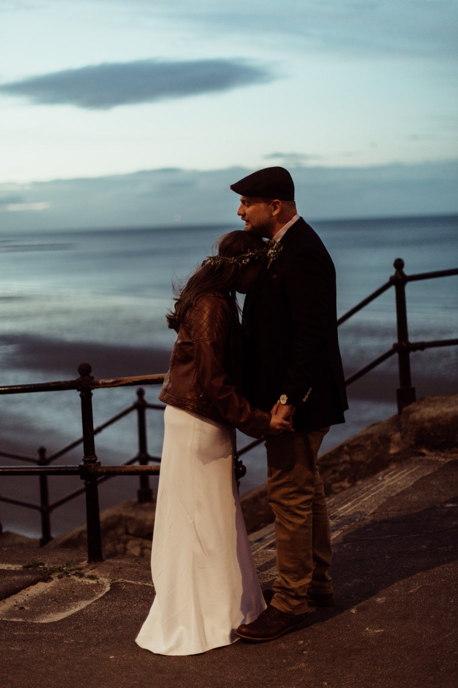 bride and groom taking a moment during sunset time in Tynemouth