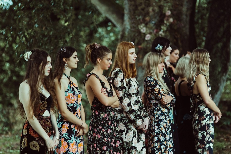 bridesmaids wearing colourful dresses for outdoor ceremony