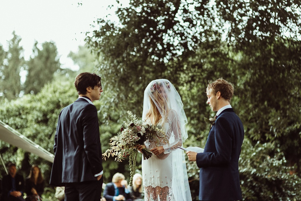 bride and groom for their outdoor wedding ceremony by New Forest wedding photographer