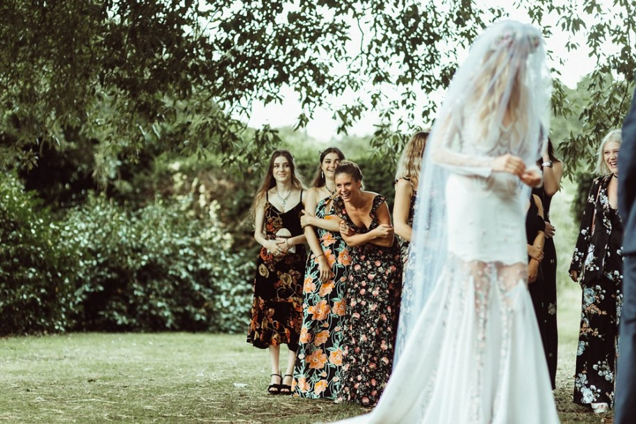 bridesmaids and bride during wedding ceremony in New Forest
