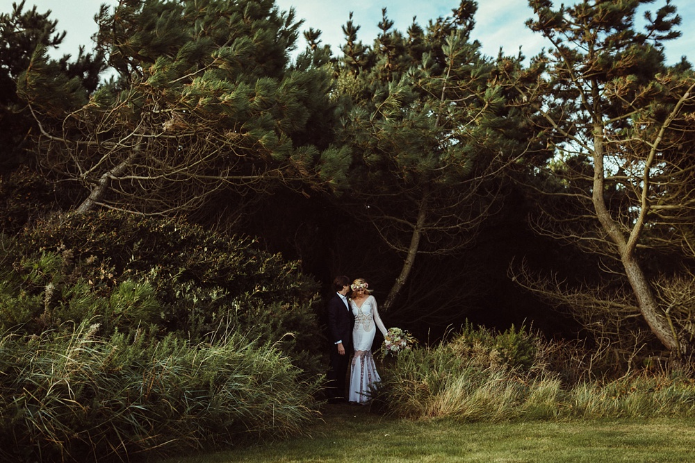 bride and groom portraits at the edge of the forest in New Forest