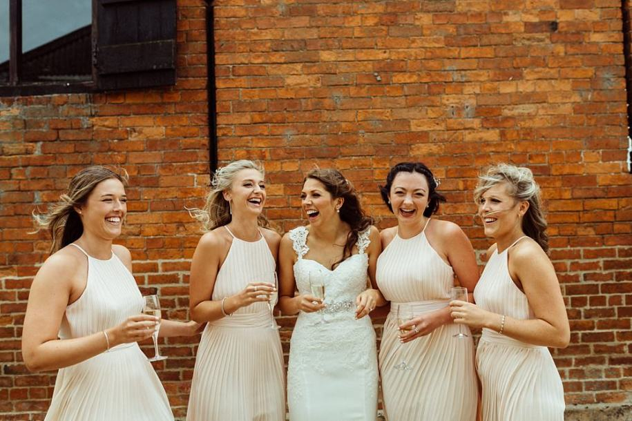 bridesmaids drinking champagne before wedding