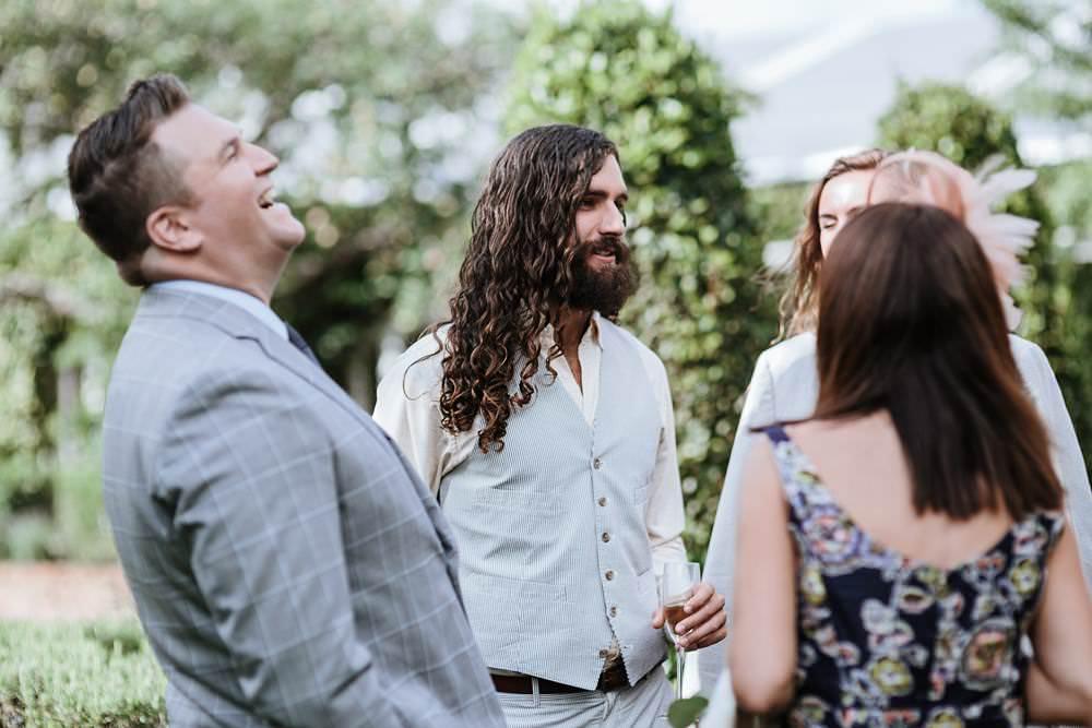 guests laughing at northbrook park wedding