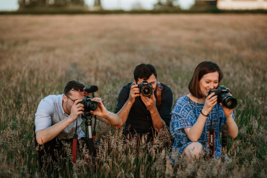 feed the vendors wedding planning tips image of photographers shooting in grass