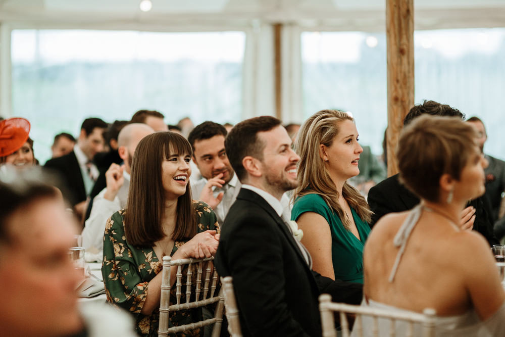 guests during speeches for marquee wedding