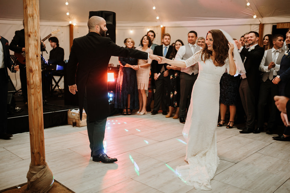 bride and groom first dance during marquee wedding