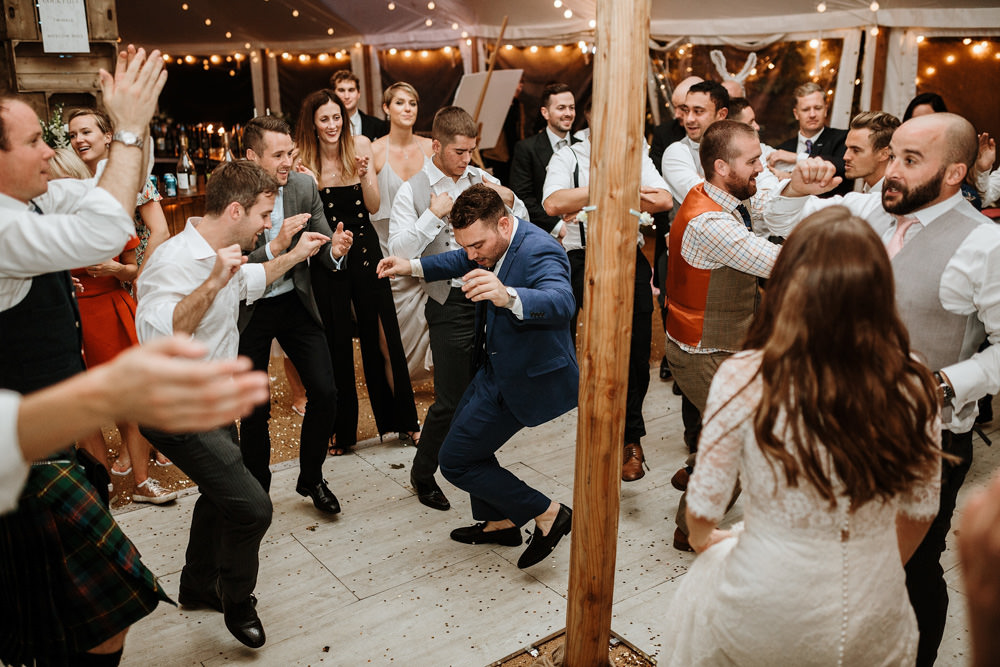 guests during marquee wedding reception