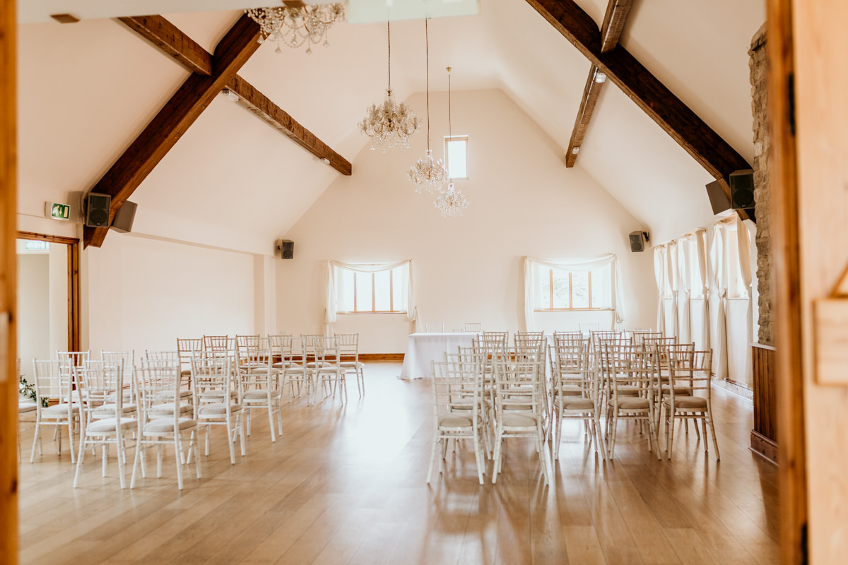 wedding ceremony area inside The Barn at Berkeley Wedding Venue Cotswolds   Green Antlers Photography