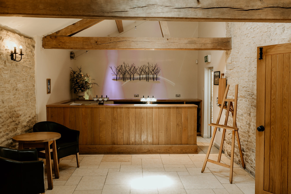 bar area at The Kingscote Barn Wedding venue by Cotswolds wedding photographers