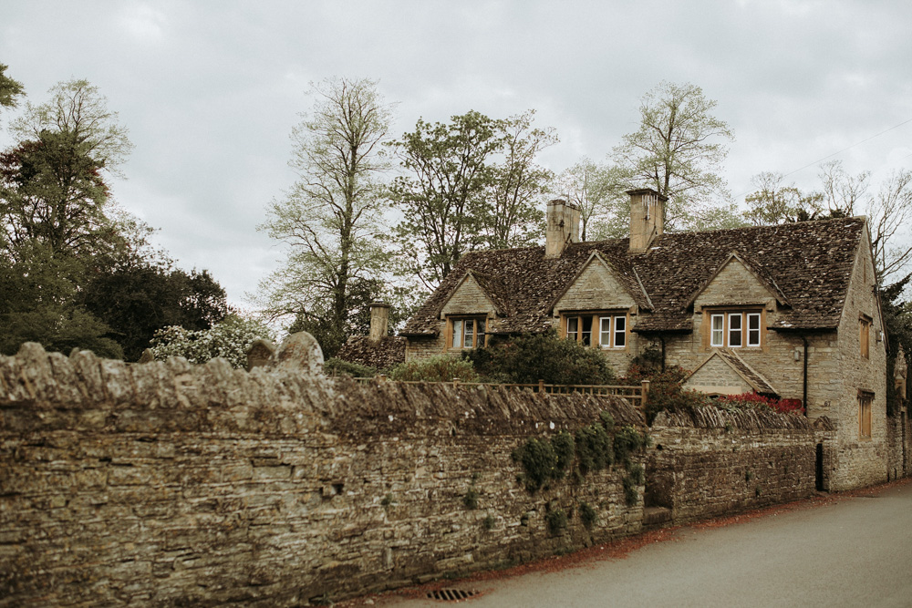 stone house with stone wall in the Cotswolds countryside