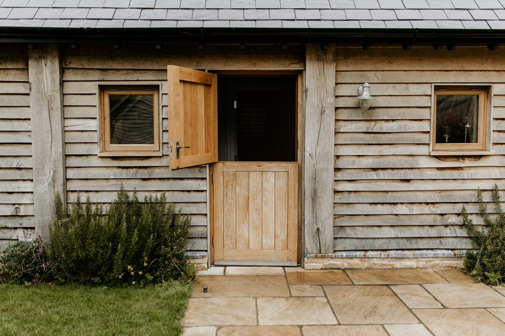 wooden barn at The Barn at Upcote Cotswolds wedding venue