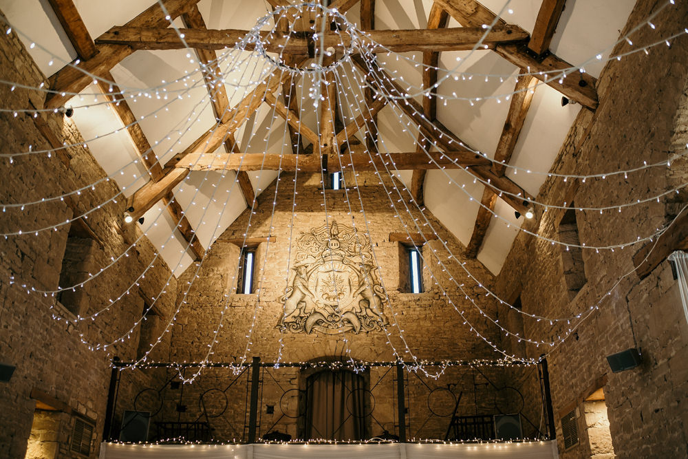 high ceiling and wooden beams of The Great Thythe Barn Cotswolds wedding venue