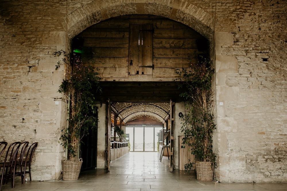 entrance to the reception area at Stone Barn by Cotswolds Wedding Photographers