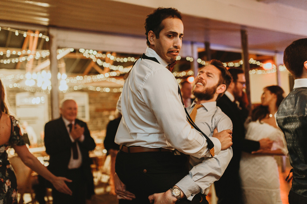 guests being silly during plas dinam country house wedding reception
