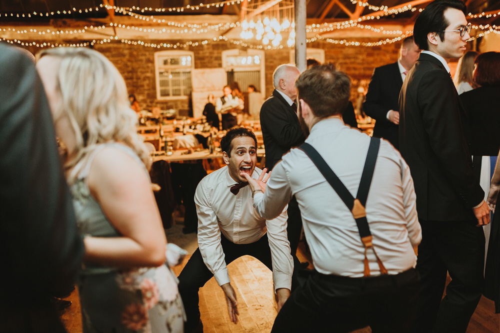 dancing groomsmen at plas dinam country house wedding reception