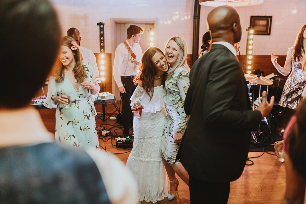 bride and friend on dance floor during plas dinam country house wedding reception Wales