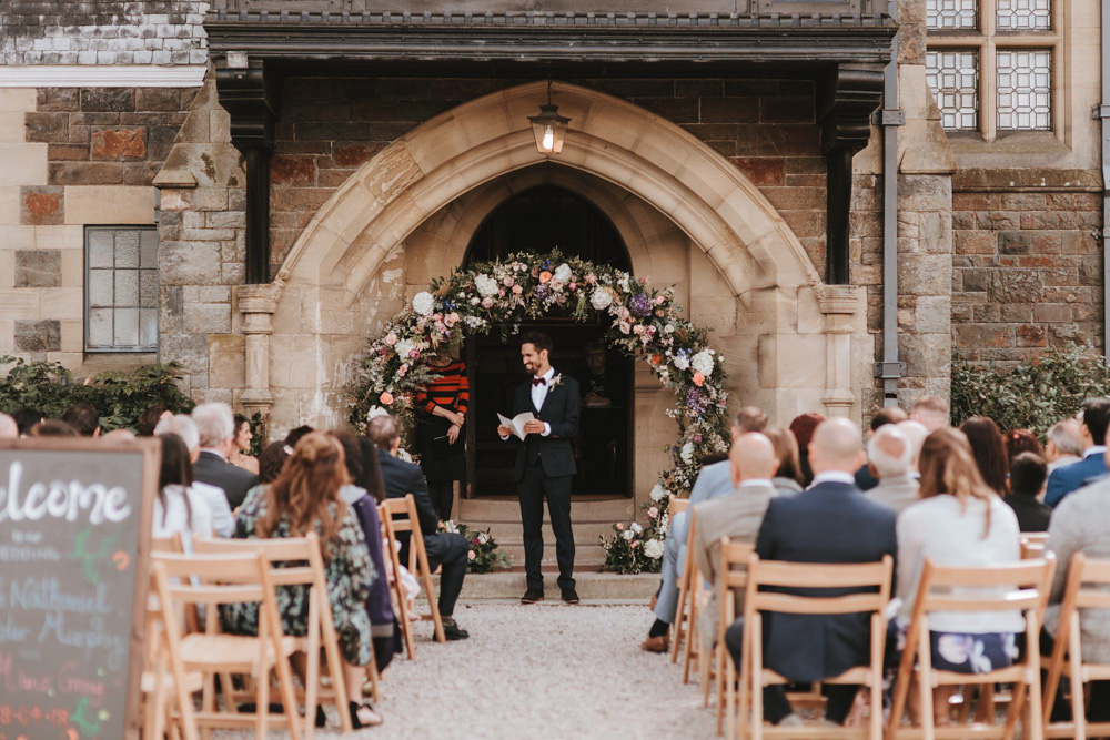 reading during outdoor wedding ceremony plas dinam country house