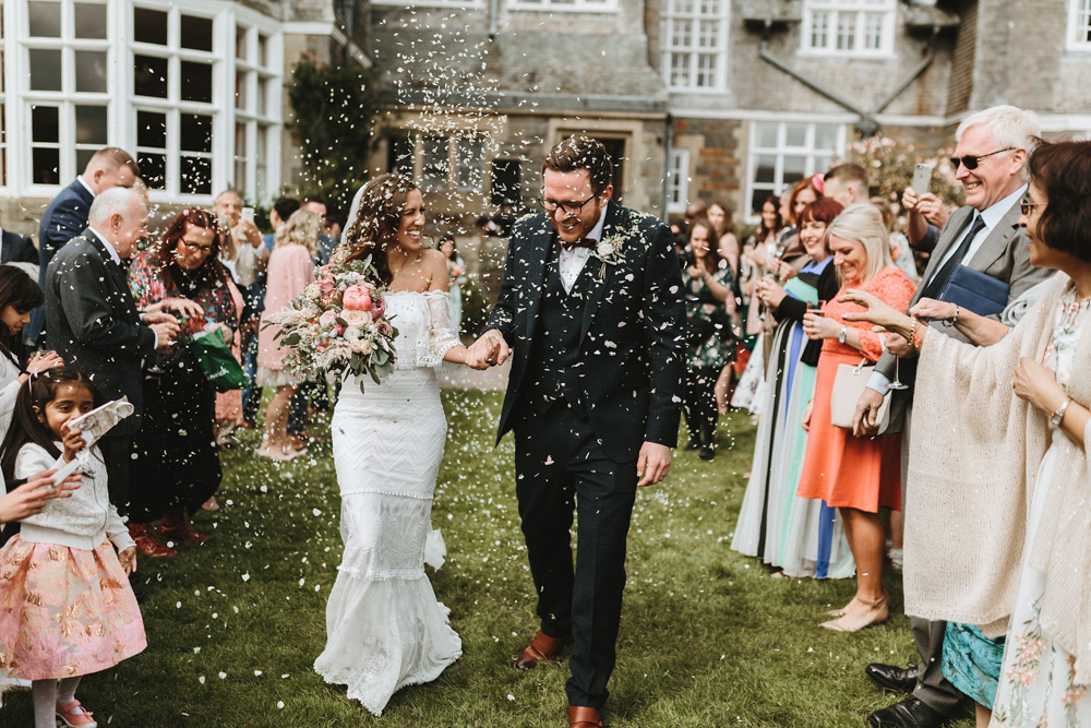 confetti shot at plas dinam country house after their wedding ceremony outdoors
