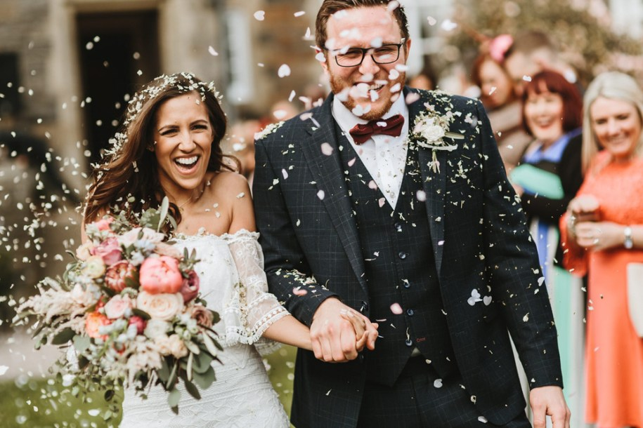 fun confetti shot outdoors after wedding ceremony at plas dinam country house