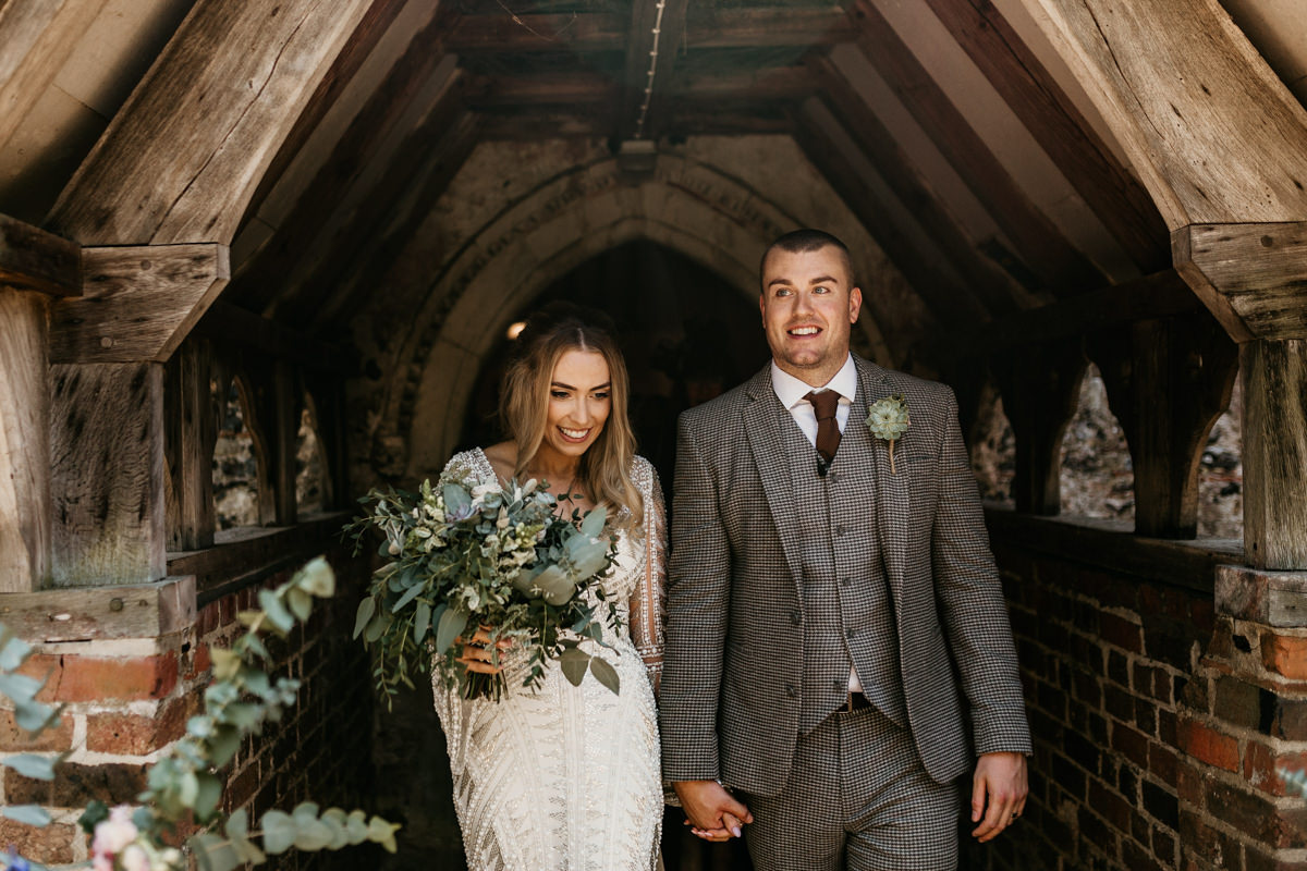 bride and groom coming out of the church by Canterbury wedding photographers
