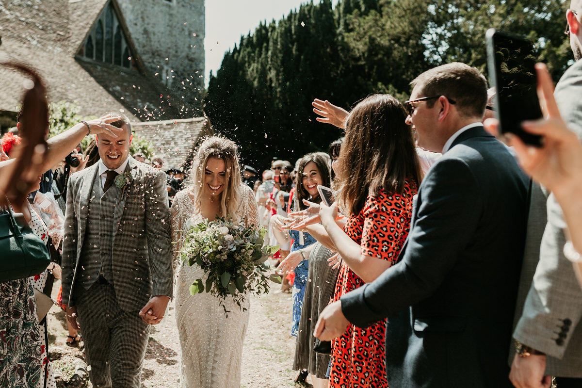 natural confetti outside church by Canterbury wedding photographers