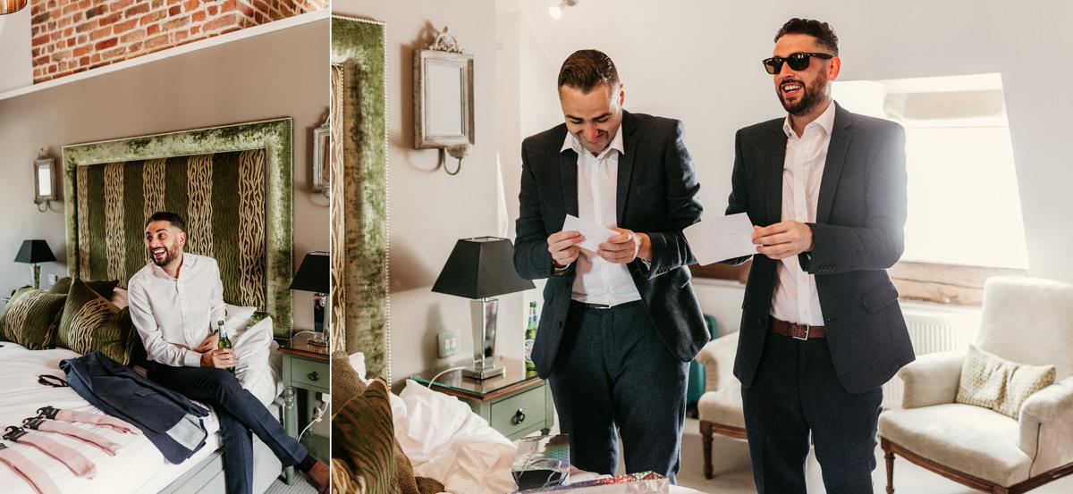 groomsmen getting ready in hotel room before wedding