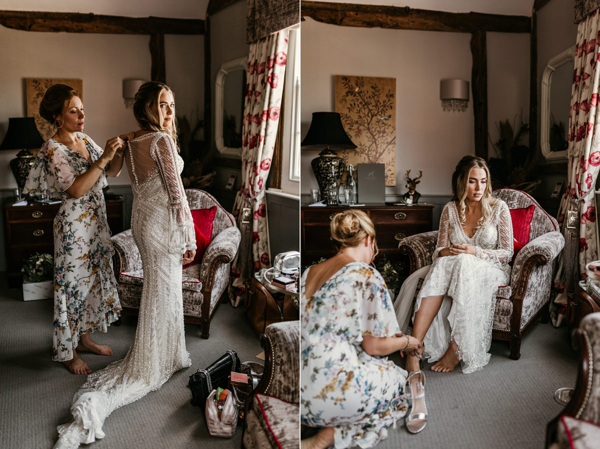 bride getting ready in the morning wearing a Justin Alexander wedding dress with beads before her Preston court wedding by Canterbury wedding photographers