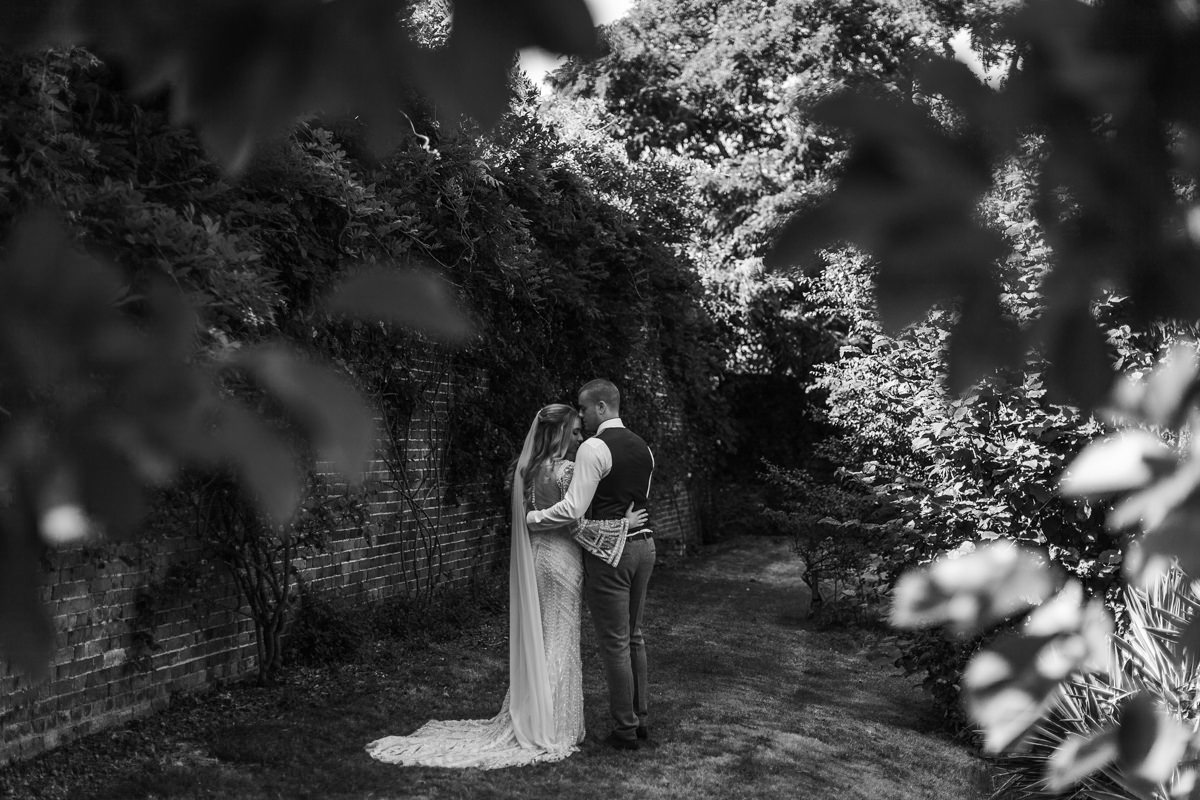 black and white image of bride and groom portraits at preston court wedding venue by Canterbury wedding photographers