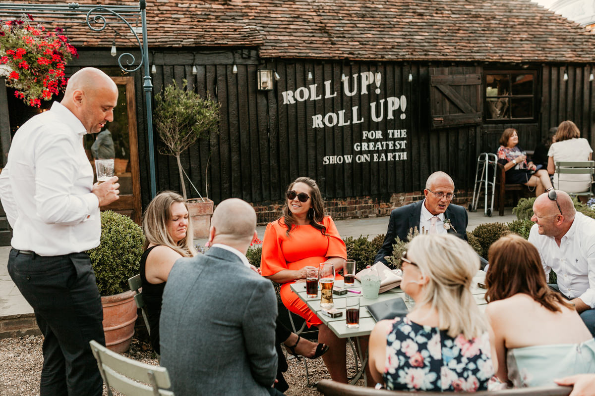 guests in the garden at preston court wedding venue by Canterbury wedding photographers