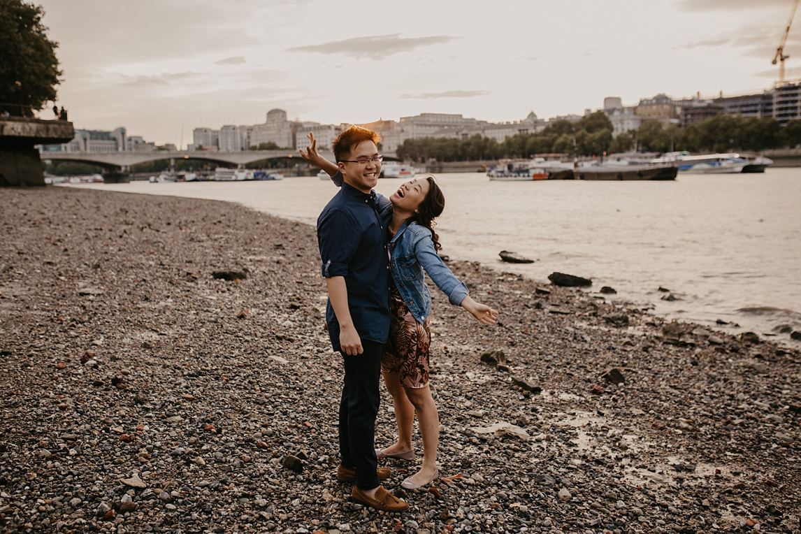 fun couple on southbank for their london engagement photo session