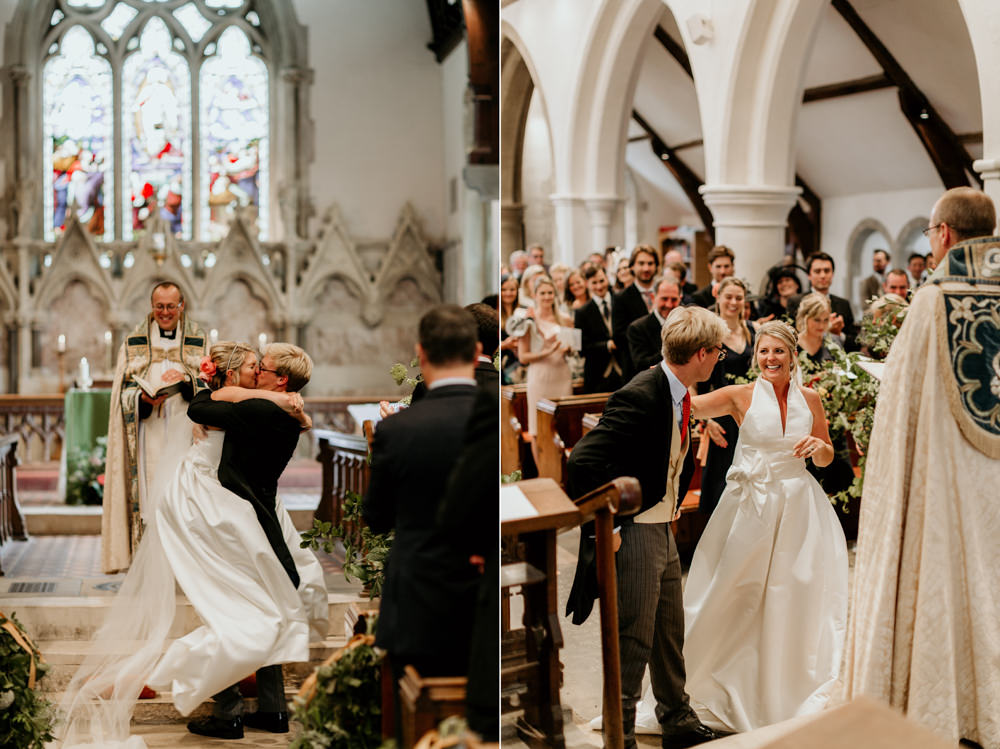 bride and groom first kiss during the church wedding ceremony Chichester