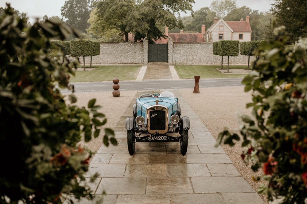blue Austin 7 Ulster vintage car outside The Kennels Goodwood wedding venue England