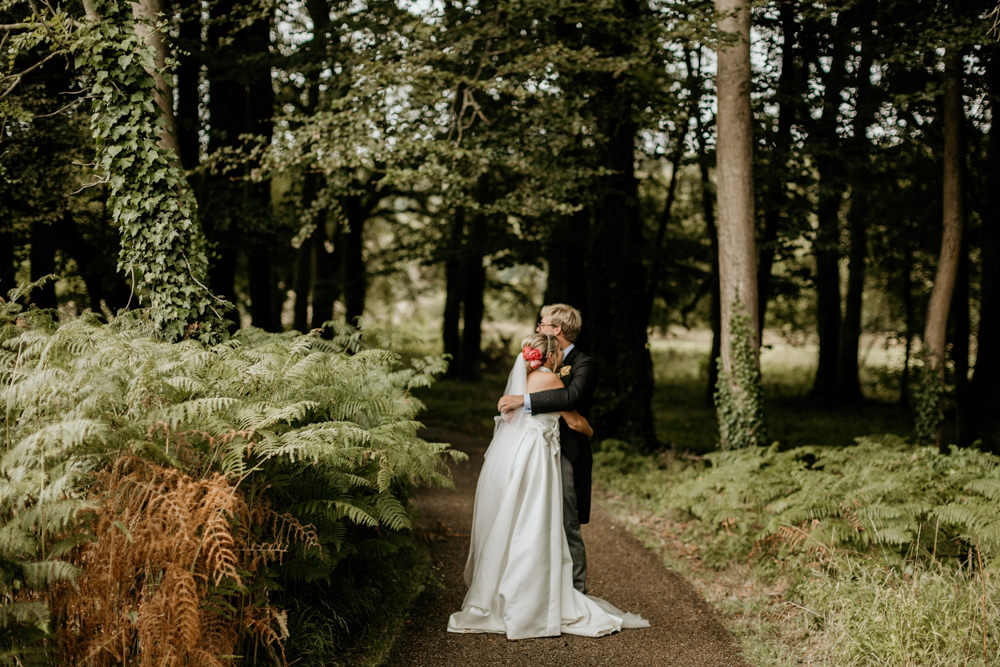 bride and groom wedding portraits in the forest at The Kennels Goodwood wedding venue South England