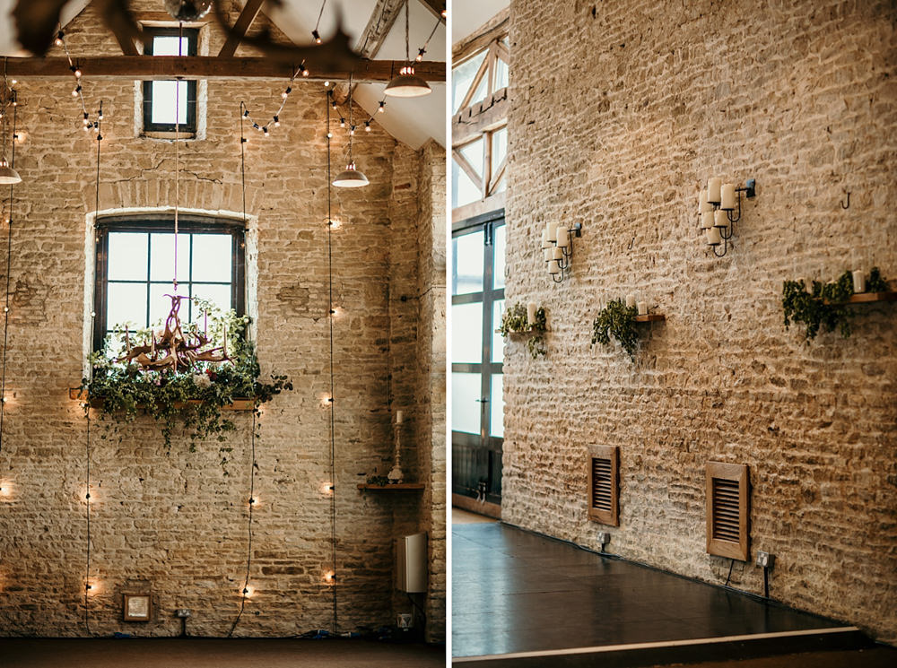 stone wall decorations with flowers and candles in the Stone Barn for wedding at Merriscourt Barn by Cotswolds wedding photographer | Green Antlers Photography