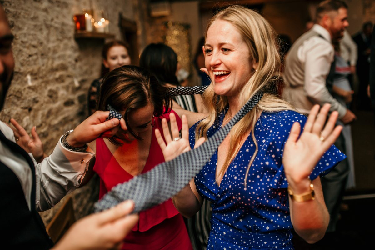 guests having fun during the wedding party at Merriscourt Barn Wedding venue by Cotswolds wedding photographer