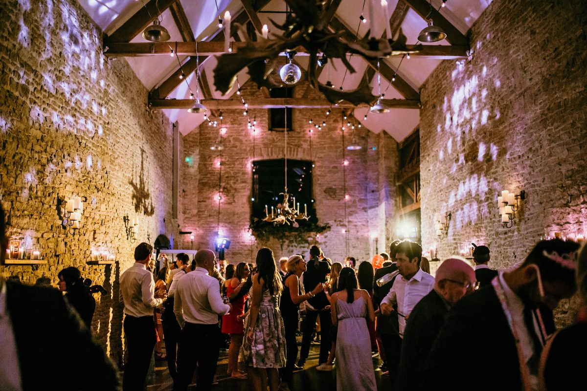 wedding guests during the party in the evening at Merriscourt Barn Wedding venue by Cotswolds wedding photographer
